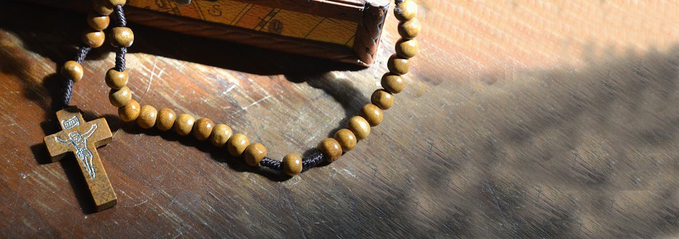 Rosary on Wood Table